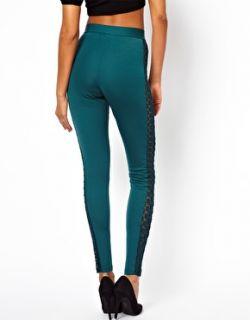 Pantalones de talle alto con acabado en punto roma y panel de encaje de en