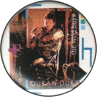 "Duran Duran   The Wild Boys (Roger Taylor in Leather with ""The Wild Boys"" in White on Side and Logo Below in Pink)   1 1/4"" Button / Pin: Clothing"