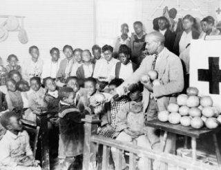 1930 photo Typical colored school near Shaw, Mississippi. It is held in a chu a7